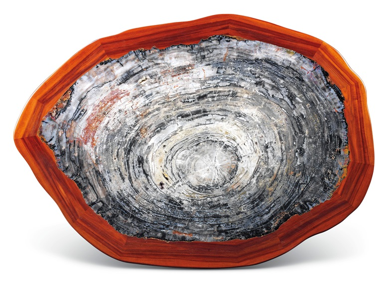 A large petrified wood table. 40 cm x 146 cm x 105.5 cm. Estimate £10,000-15,000. Offered in Sculpted by Nature Fossils, Minerals and Meteorites, 4-21 May 2020, Online
