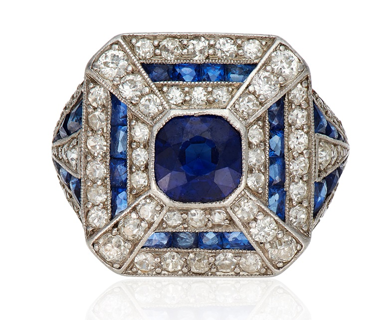 Art Deco sapphire and diamond ring. Set with a cushion-cut sapphire, within an old and single-cut diamond and calibre-cut sapphire surround. Sold for $6,875 on 12 Feb 2020, Online