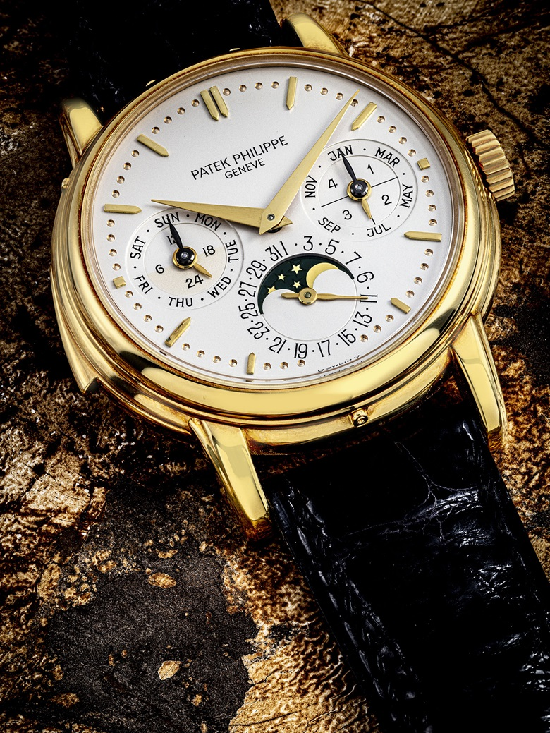 Patek Philippe. A very rare 18k gold automatic minute repeating perpetual calendar wristwatch with moon phases, 24-hour and leap-year indication, signed Patek Philippe, Geneve, ref. 3974, 1991