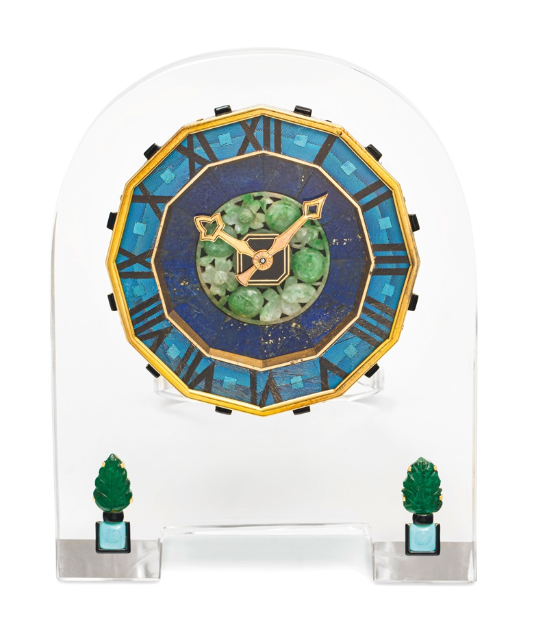Art Deco rock crystal, lapis lazuli, kingfisher feather, emerald, turquoise and enamel desk clock, Cartier, 1930s. Estimate CHF90,000-130,000. Offered in A lifetime of collecting – A Collection of 101 Cartier Clock, 7-21 July 2020, Online