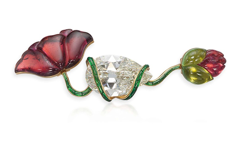 A tourmaline and diamond flower brooch, by JAR. Sold for CHF 1,179,000 on 14 May 2012 at Christie's in Geneva