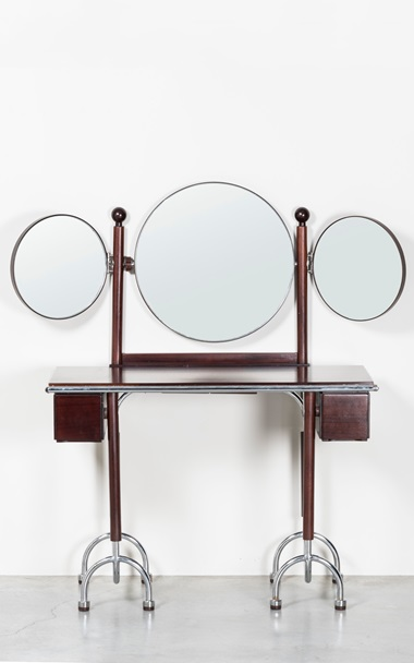 Roberto Gabetti, Aimaro Isola and Guido Drocco. Dressing table from the Trilogia series, 1970s. Chromium-plated metal, rosewood, manufactured by ARBO, Italy. Estimate €8,000-12,000. Offered in Nilufar [100] Design Selections, online, 8-29 July
