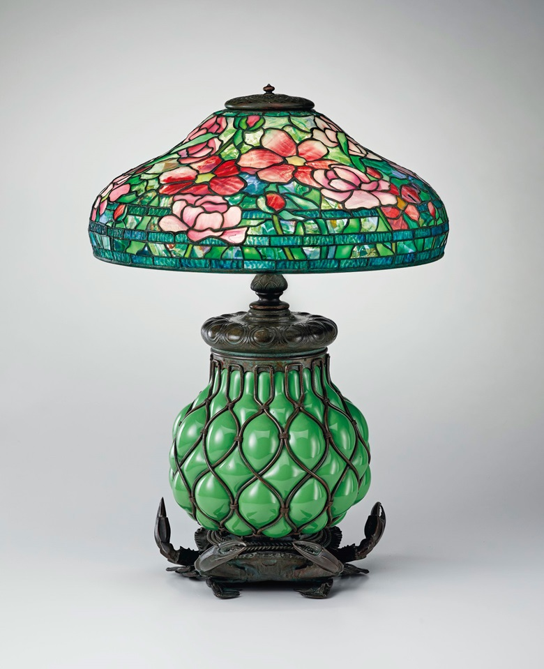 Tiffany Studios, 'Peony' table lamp, circa 1902, with rare 'Crab' base, circa 1902. 23½ in (58.4 cm) high, 18 in (45.7 cm) diameter of shade. Offered in Creating Space Design Online, 21-31 July