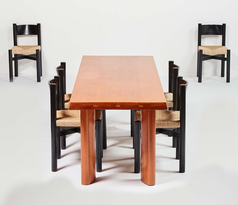 Charlotte Perriand, Dining table, 1968. Rectangular top in ash wood, bevelled edges, visible dowels, on four elliptic legs. Height 28.1 in, length 78.1 in, width 29.9 in. Steph Simon edition. Charlotte Perriand, Six rush chairs, 1960. Structure and backrest in solid black lacquered wood, straw seat. Height 30 in, width 16.5 x 16.1 in. Seat height 17.7 cm. Steph Simon edition. Offered in La
