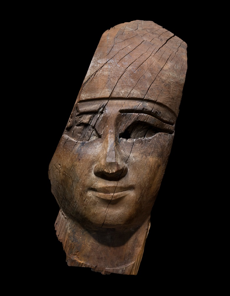 Face from an anthropoid coffin, Third Intermediate to Late Period of Ancient Eygpt, 21-26th dynasty, circa 1070-525 BC. 17 in (43.8 cm). Offered in La Biennale Paris, 24 September-8 October, Online