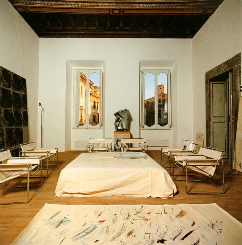 The present lot illustrated in Twombly's home at Via di Monserrato, Rome, 196970. Between windows with view on Piazza dei Ricci, sculpture by John Chamberlain. Photo © Ugo Mulas. Art © Cy Twombly Foundation; © 2020 Fairweather & Fairweather LTD  Artists Rights Society (ARS), New York