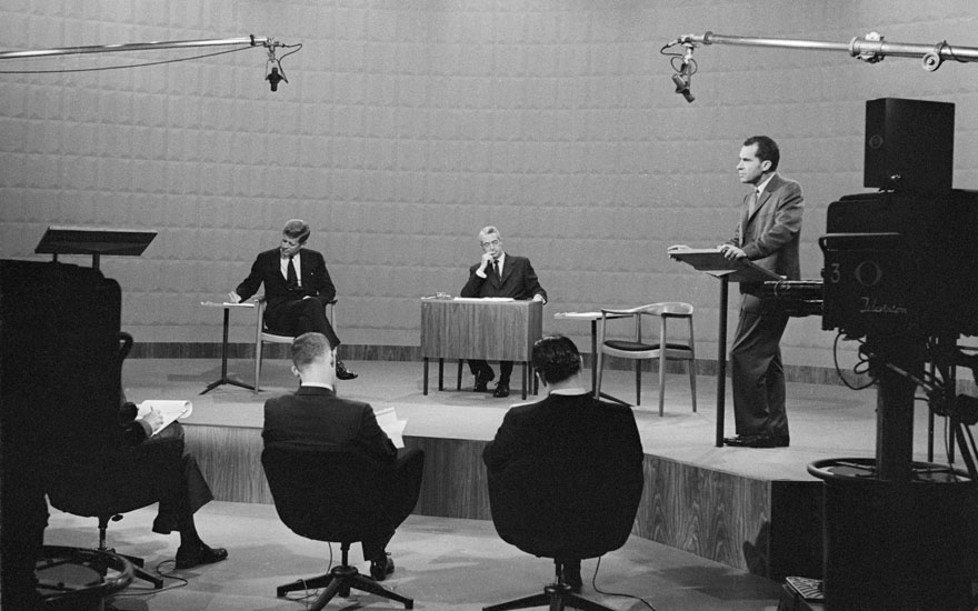Vice President Richard Nixon speaks during the presidential debate of 1960, while his opponent, Senator John F. Kennedy, takes notes. The moderator is Howard K. Smith. Photo Bettmann  Getty Images