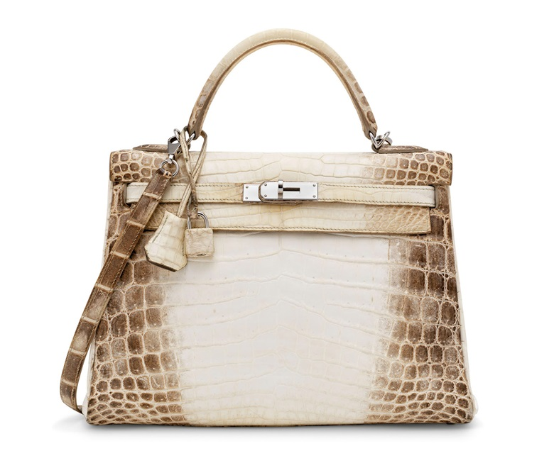 A rare, matte white Niloticus Crocodile Retourné Kelly 32 with palladium hardware, Hermès, 2014. 32 w x 23 h x 10 d cm. Sold for £60,000 on 17 November 2020, Online