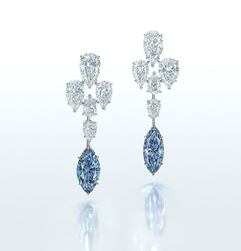 Superb coloured diamond and diamond earrings. Fancy Intense blue marquise brilliant-cut diamonds of 3.29 and 3.29 carats, ten pear brilliant and pear modified brilliant-cut diamonds from 1.86 to 0.51 carats, platinum and gold, 4.7 cm. Estimate HK$25,000,000-35,000,000. Offered in Magnificent Jewels on 29 November at Christie's in Hong Kong