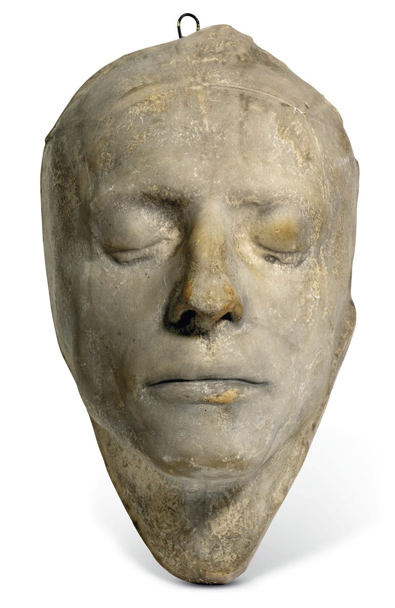 John Keats, Death Mask, circa 1898-1905. Plaster cast with light brown patina, inscribed 'C. Smith London No 231' at crown and 'Keats' at throat, hanging hook at back. Approximately 11 x 6 x 6 in (27.5 x 16.0 x 15.5 cm), pale grey paint applied over shellac base as common (paint a little rubbed). Estimate £12,000-16,000. Offered in Valuable Books and Manuscripts