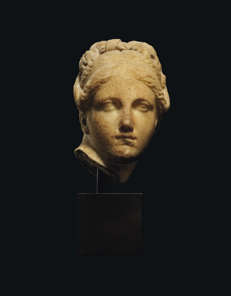 A Greek marble head of Aphrodite, Hellenistic period, circa 2nd century BC. 6 in (15.2 cm) high. Estimate £10,000-15,000. Offered in Antiquities on 16 December 2020 at Christie's in London
