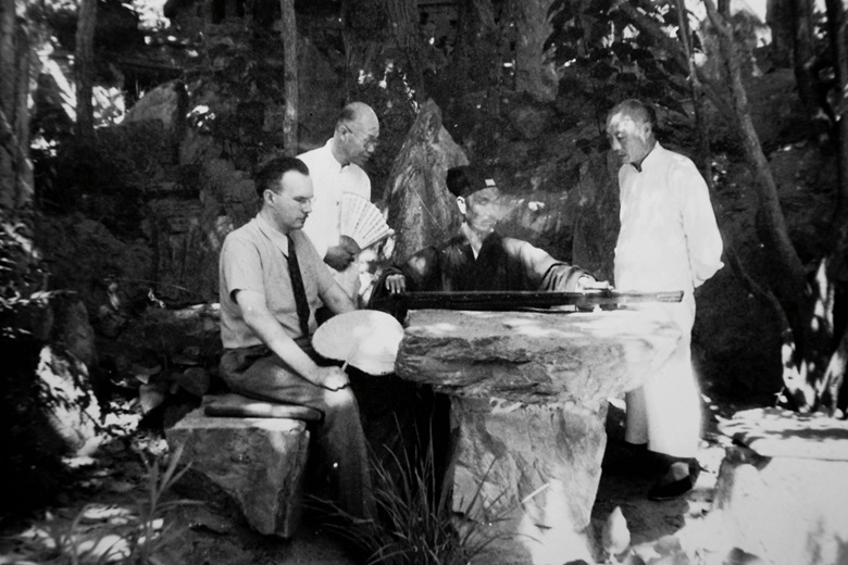Robert van Gulik, left, watching an acquaintance play the qin. Beiping (present day Beijing), 1946. Courtesy of the Van Gulik family