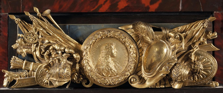 Detail of the cabinet's ormulu medallion showing Louis XIV in armour