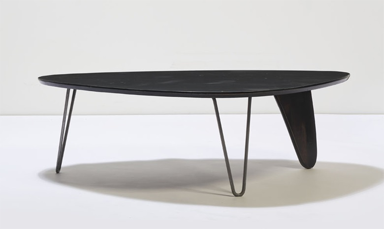 Isamu Noguchi (1904-1988), 'Rudder' Coffee Table, model IN-52, 1944; manufactured by Hermann Miller in 1948. Chrome-plated metal and stained birch. 40 x 127 x 90 cm (15¾ x 50 x 35½ in). Estimate €18,000-22,000. Offered in Design on 2 December 2020 at Christie's in Paris