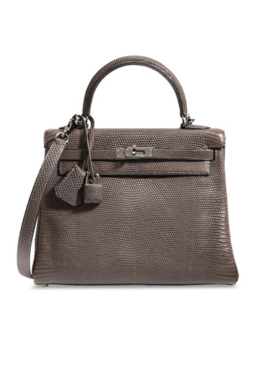 A matte ébène salvator lizard retourné Kelly 25 with ruthenium hardware, Hermès, 2005, from the collection of Susan Casden. 25 w x 18 h x 9 d cm. Sold for $37,500 in Handbags & Accessories Online The New York Edition, 24 November-10 December 2020, Online