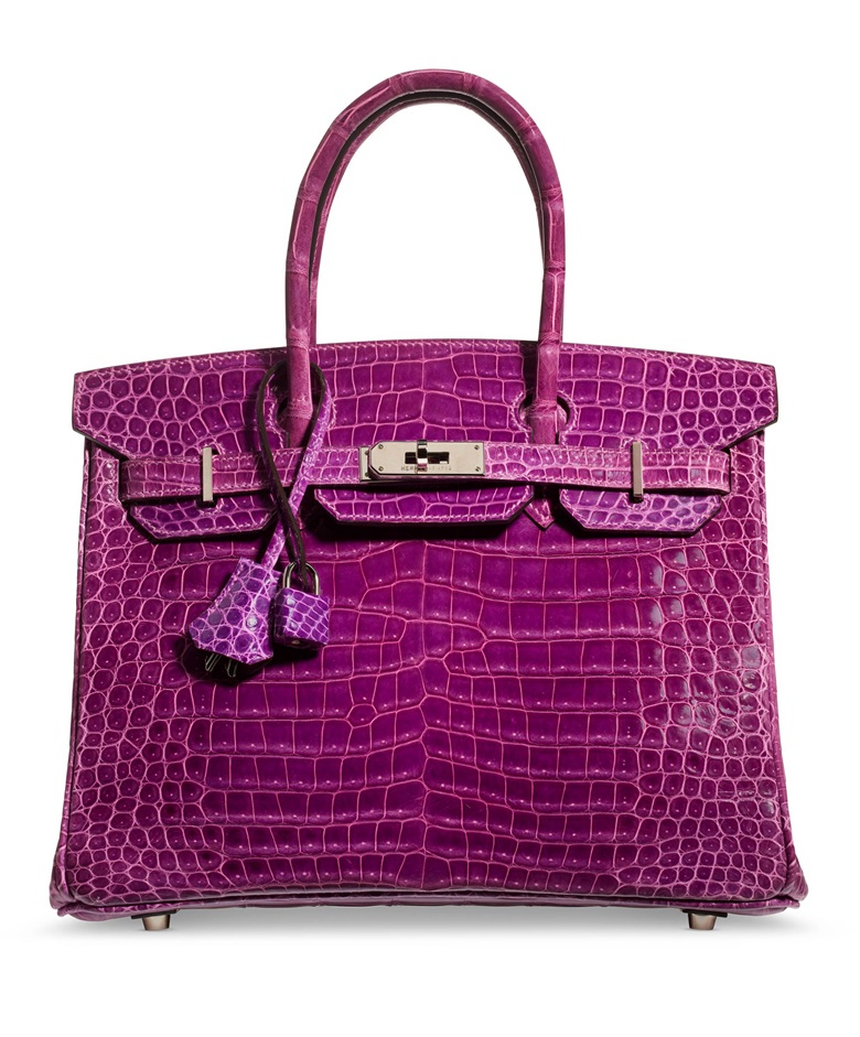 A shiny violet porosus crocodile Birkin 30 with palladium hardware, Hermès, 2005, from the collection of Susan Casden. 30 w x 22 h x 15 d cm. Sold for $47,500 in Handbags & Accessories Online The New York Edition, 24 November-10 December 2020, Online