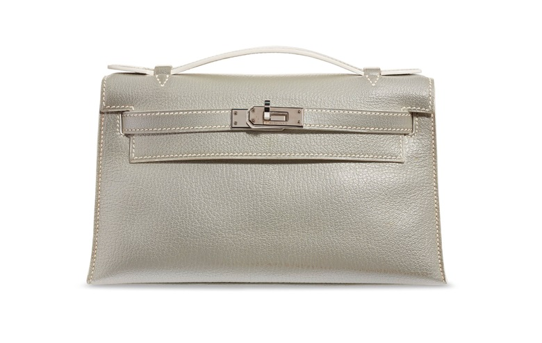 A rare, metallic silver chèvre leather Kelly pochette with palladium hardware, Hermès, 2005, from the collection of Susan Casden. 22 w x 13 h x 6 d cm. Sold for $20,000 in Handbags & Accessories Online The New York Edition, 24 November-10 December 2020, Online