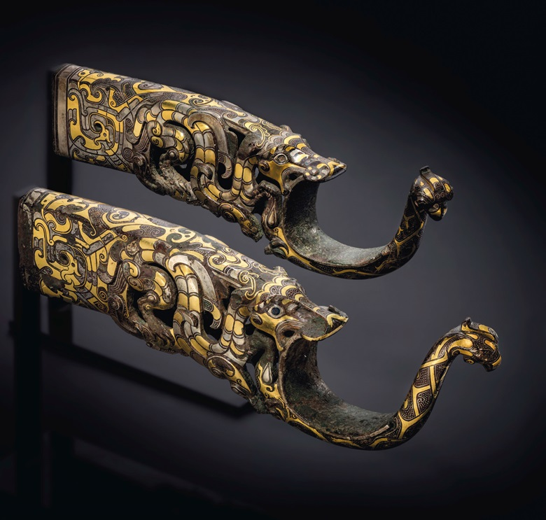 A rare and magnificent pair of gold and silver-inlaid bronze chariot fittings, Eastern Zhou dynasty, 4th-3rd century BC. 10¼ in (26 cm) long. Sold for £1,522,500 on 3 November 2020 at Christie's in London
