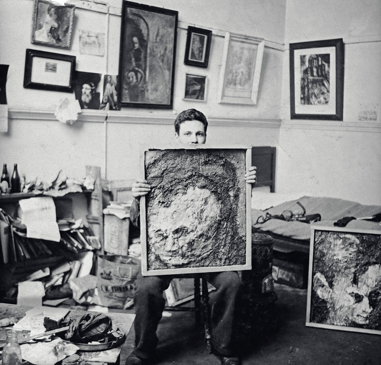 Frank Auerbach in the studio circa 1955, with Head of Leon Kossoff (1954). Photo and artwork copyright the artist, courtesy the artist and Marlborough, London