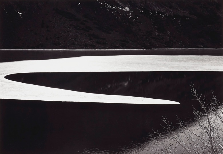 Ansel Adams (1902-1984), Ice on Ellery Lake, Sierra Nevada, California, c. 1959. Gelatin silver print, mounted on board, printed 1979. Imagesheet 13 x 18 ¾ in (33 x 47.6 cm); mount 22 x 28 in (55.8 x 71.1 cm). Estimate $10,000-15,000. Offered in Ansel Adams and the American West, 25 March-8 April, Online