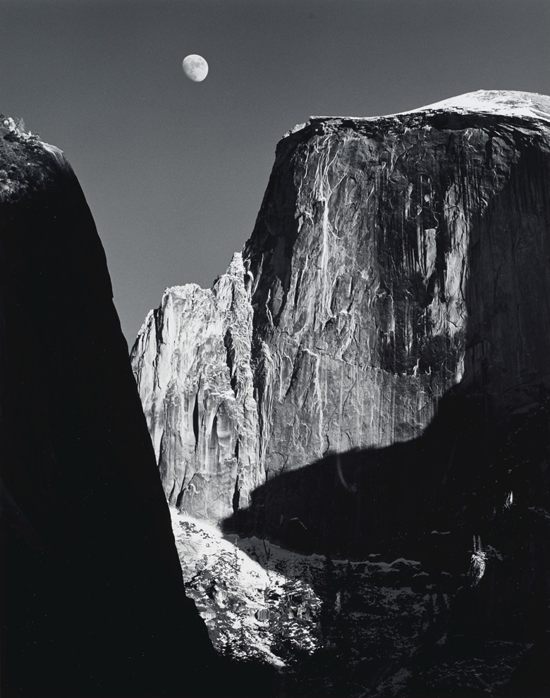Ansel Adams (1902-1984), Moon and Half Dome, Yosemite National Park, California, 1960. Gelatin silver print, mounted on board, printed 1962. Imagesheet 13¼ x 10½  in (33.6 x 26.6 cm); mount 18 x 14 in (45.7 x 35.5 cm). Estimate $30,000-50,000. Offered in Ansel Adams and the American West, 25 March-8 April, Online