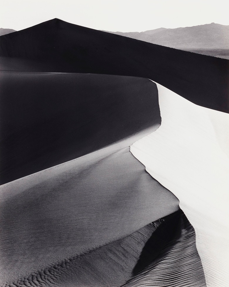 Ansel Adams (1902-1984), Sand Dunes, Sunrise, Death Valley National Monument, California, c. 1948. Gelatin silver print, mounted on board, printed 1973-1977. Imagesheet 18¼ x 14¾ in (46.3 x 37.4 cm); mount 27½ x 21¾ in (69.8 x 55.2 cm). Estimate $15,000-25,000. Offered in Ansel Adams and the American West, 25 March-8 April, Online