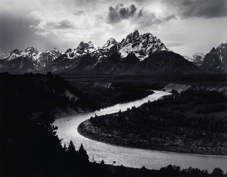 Ansel Adams (1902-1984). The Tetons and the Snake River, Grand Teton National Park, Wyoming, 1942. Gelatin silver print, mounted on board, printed probably 1963-1973. Imagesheet 10½ x 13½ in (26.6 x 34.2 cm); mount 14 x 18 in (35.5 x 45.7 cm). Photographs from the Center of Creative Photography. Estimate $20,000-30,000. Offered in Ansel Adams and the American West, 25 March-8 April,
