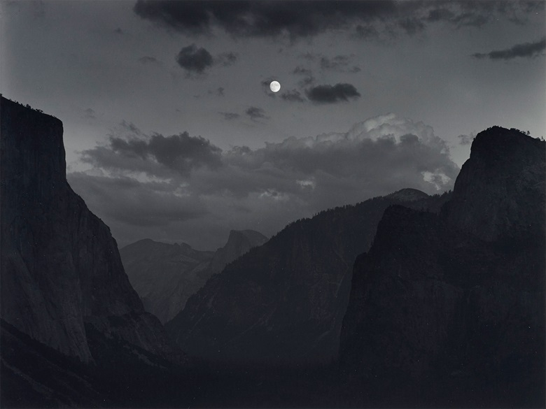 Ansel Adams (1902–1984), Yosemite Valley, Moonrise, Yosemite National Park, California, c. 1935. Gelatin silver print, mounted on board, printed 1973-1977. Imagesheet 10 x 13⅜ in (25.4 x 33.9 cm); mount 16 x 20 in (20.6 x 50.8 cm) Estimate $8,000-10,000. Offered in  Ansel Adams and the American West, 25 March-8 April, Online
