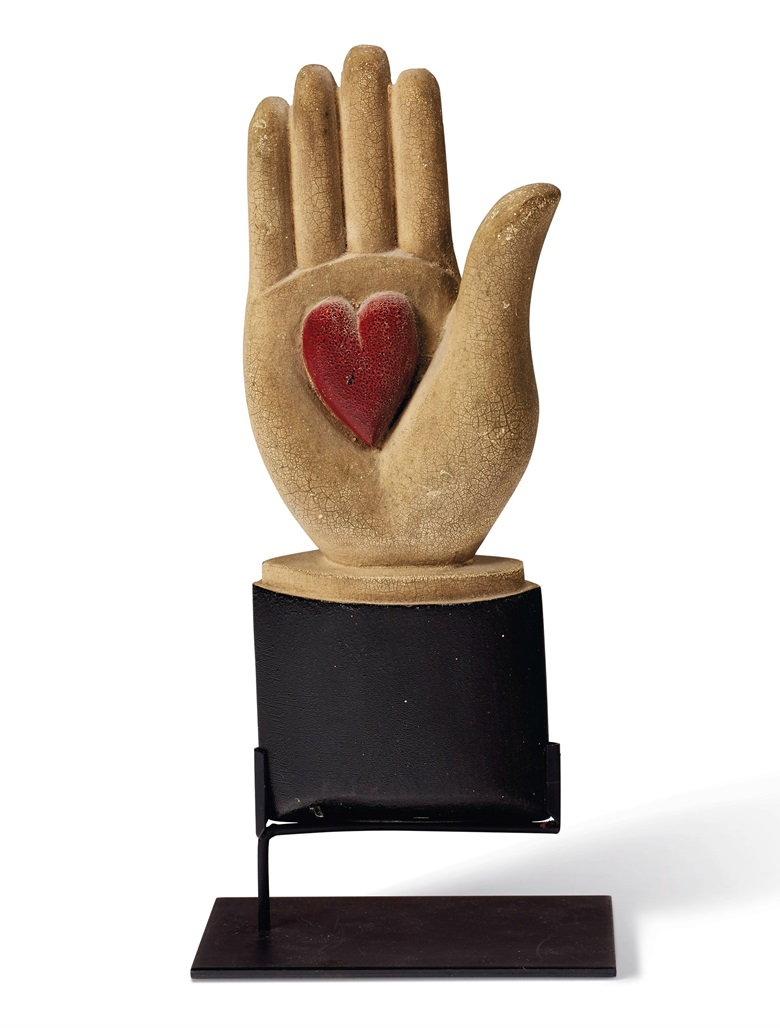 A carved and painted wood heart-in-hand lodge symbol, American, late 19th century. 9 in high. Estimate $3,000-5,000. Offered in In Praise of America Important American Furniture, Folk Art, Silver, Prints and Broadsides on 22 January 2021 at Christie's in New York