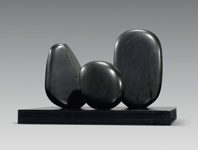 Dame Barbara Hepworth (1903-1975), Three Round Forms, 1971. Slate, on a black painted wooden base. 14¼ in (36.2 cm) wide. Estimate £200,000-300,000. Offered in the Modern British Art Evening Sale on 1 March at Christie's in London. Artwork © Bowness