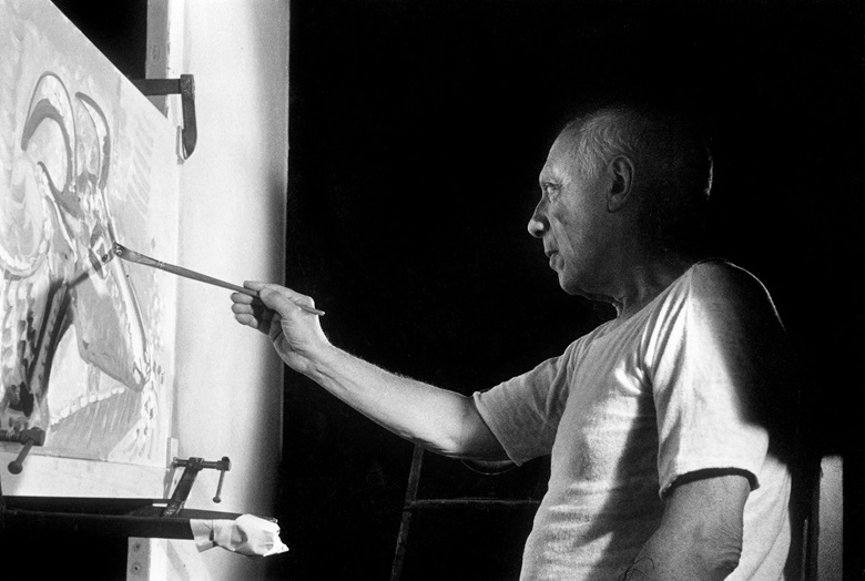 Pablo Picasso painting on the set of the film Le Mystère de Picasso in 1955. Photo © Jerome Brierre  Bridgeman Images. Artwork © Succession PicassoDACS, London 2020