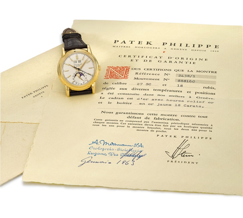 Ref. 24381 with original certificate and envelope, from the family of the original owner. Patek Philippe. A very fine and extremely rare 18K gold perpetual calendar wristwatch with sweep centre seconds, moon phases and screw back, original Certificate of Origin and envelope. Signed Patek Philippe, Genève, ref. 2438-1, movement no. 888'160, case no. 2'619'199, manufactured