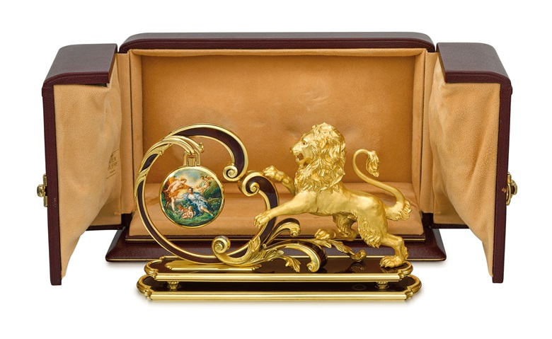 From the Collection of the late Claude Nobs, founder of the Montreux Jazz Festival. Patek Philippe. An extremely fine and unique 18K gold openface keyless lever watch with enamel miniature 'Apollon et Issé' by G. Menni, original box, unique solid 18K gold and enamel watch stand 'Lion' with original certificate and box. Signed Patek Philippe, Genève, ref.