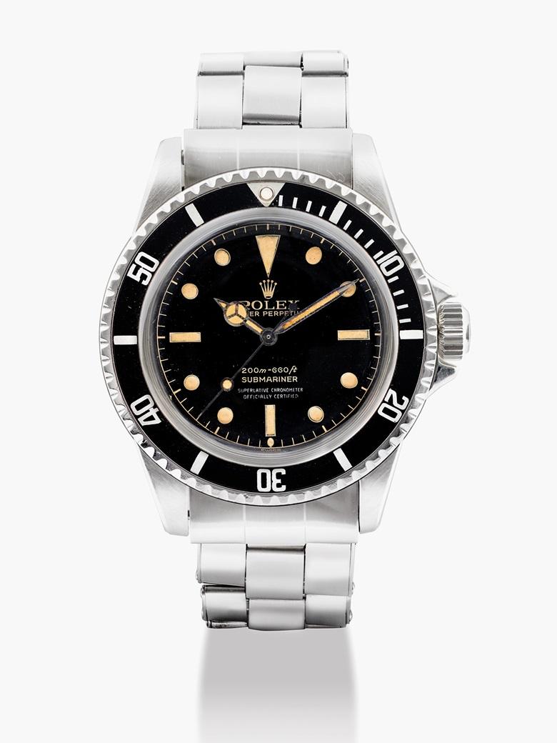 勞力士,不銹鋼自動上弦鏈帶腕錶,Submariner,型號5512,約1962年製。估價:200,000-300,000港元  26,000-39,000美元。佳士得香港於2017年5月29日舉行的精緻名錶拍賣中呈獻此拍品。