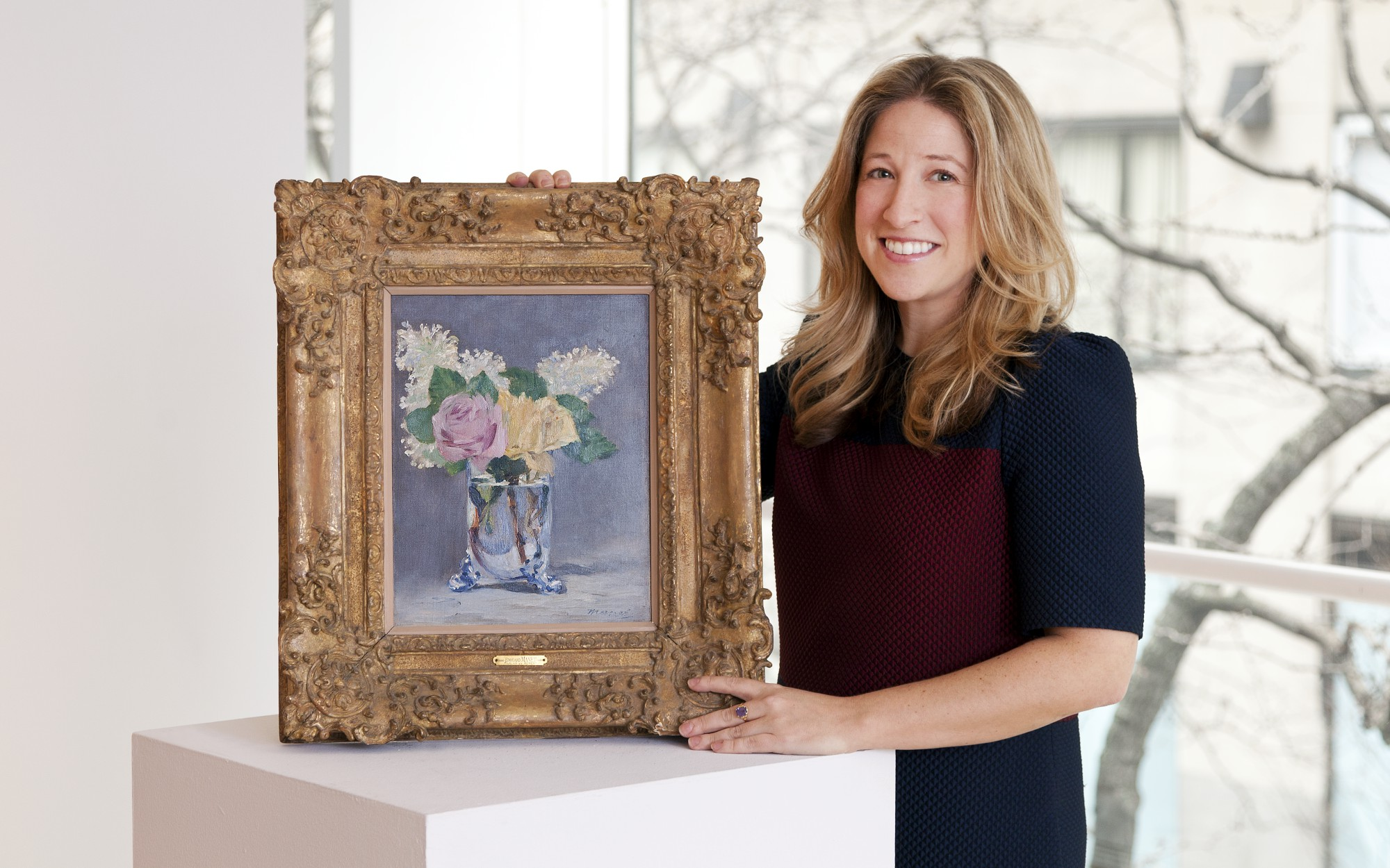 Jessica Fertig, Christie's Senior Vice President in Impressionist and Modern Art, with Edouard Manet's Lilas et roses