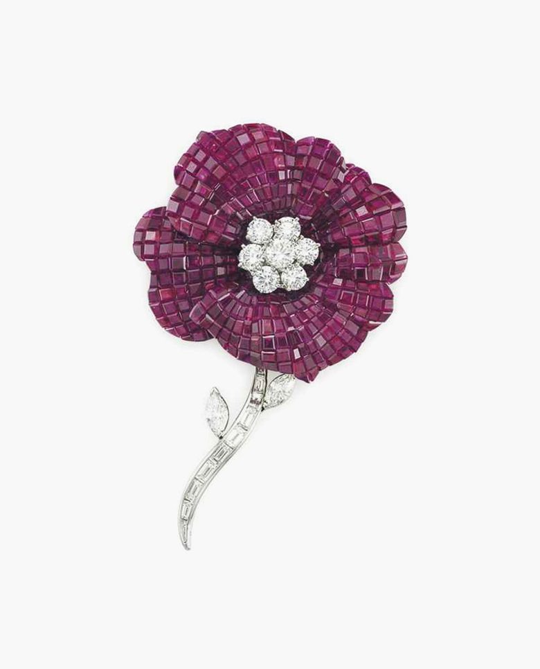 An invisibly-set ruby and diamond flower brooch, by Oscar Heyman & Brothers. Estimate $130,000–230,000. This piece is offered in the Magnificent Jewels auction on 7 December at Christie's New York