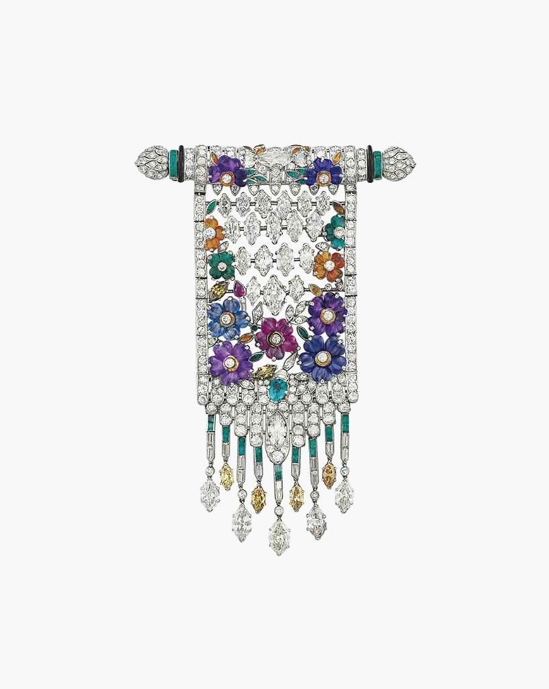 An Art Deco diamond, coloured diamond and multi-gem brooch. Estimate $60,000–80,000. This piece is offered in the Magnificent Jewels auction on 7 December at Christie's New York
