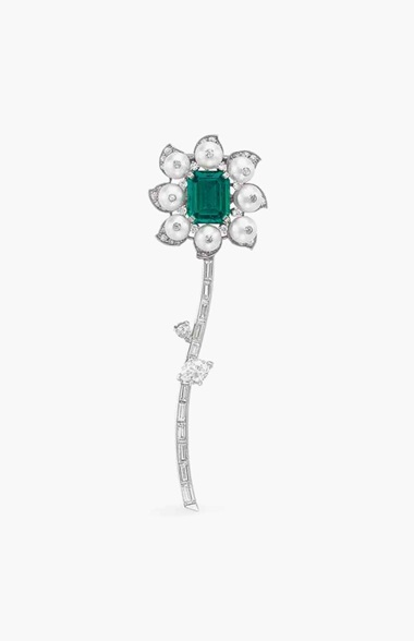 Property from the Blair Family Collection. An emerald, natural pearl and diamond flower clip brooch, mounted by Cartier. Estimate $70,000–100,000. This piece is offered in the Magnificent Jewels auction on 7 December at Christie's New York