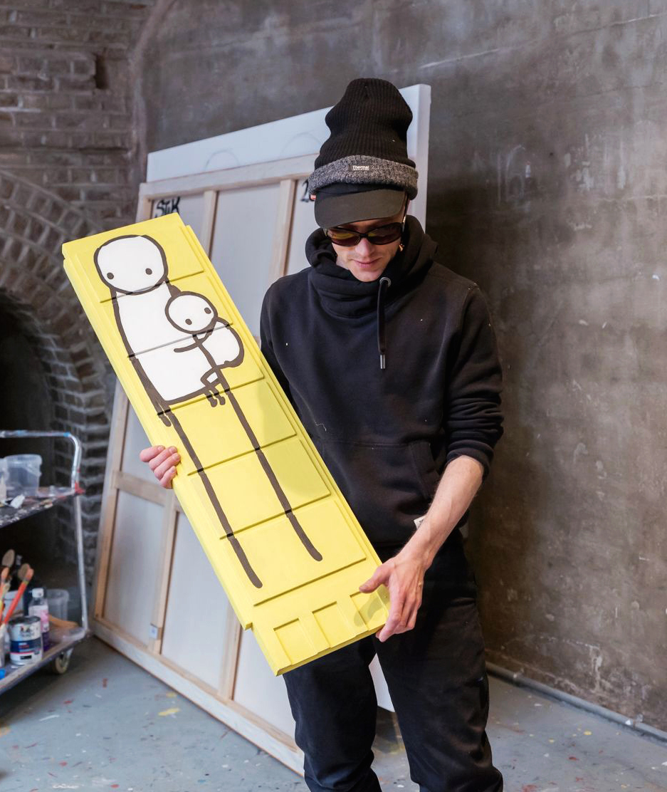 Stik in his studio with Little Big Mother. The work sold for £52,500 at Christie's London on 28 March 2018