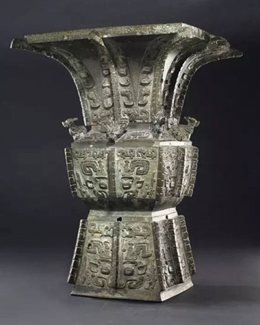A  magnificent and highly important bronze ritual wine vessel, Fangzun late Shang Dynasty, Anyang period, 12th–11th century B.C. 20⅝ in (52.4 cm) high, gold and silver-inlaid wood  stand, Japanese double wood box. Estimate $6,000,000–8,000,000. This work will be offered in Important Chinese Art  from the Fujita Museum, New York, 16 March 2017
