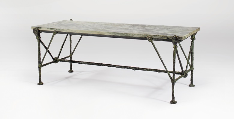 Diego Giacometti (1902-1985), A Low Table, conceived circa 1964. Bronze with green and brown patina, original marble top. Height 16 38 in (41.5 cm), Width 39 ¾ in (101 cm), Depth 19 18 in (48.5 cm).  Offered in Alberto & Diego Giacometti Masters of Design on 12 November at Christie's in New York