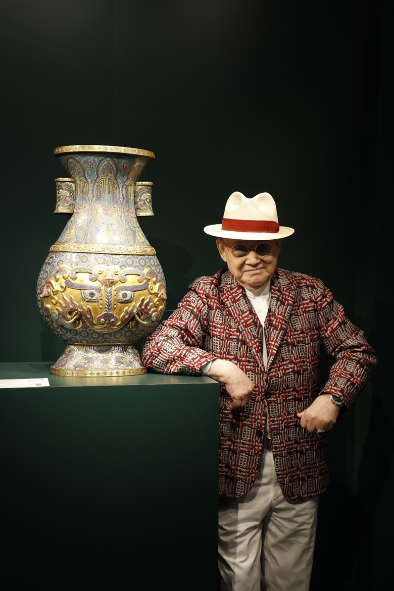 Robert Chang with the imperial cloisonné enamel 'Taotie' Hu-form vase during the preview at Christie's in Hong Kong, November 2020