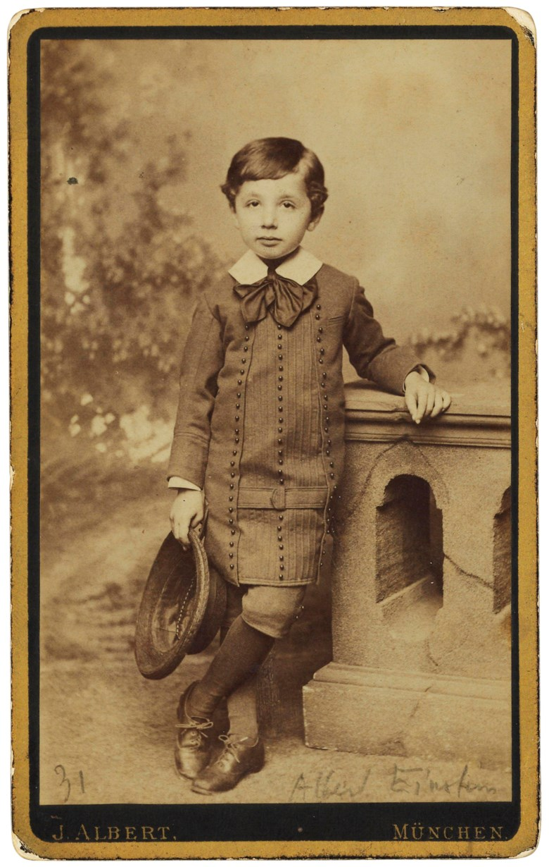 The 5-year-old Einstein, Munich, [c.1884]. Mounted on stiff black card with gilt border, photographer's name printed on lower margin, the verso printed with the photographers appointments to the royal Bavarian and imperial Russian courts, and his address at Carlstrasse 21; annotated in pencil at lower margin 31  Albert Einstein. 103 x 64 mm including mount . Estimate