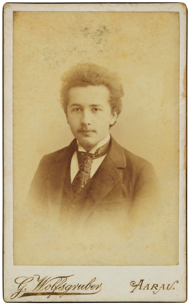 The 16-year-old prodigy, Aarau, 1895. Mounted on stiff card, photographers printed signature and details on lower margin and verso; gilt edges 104 x 64 mm including mount. Estimate                    £4,000-6,000. Offered in Einstein and Family Letters and Portraits, 2-9 May 2018, Online