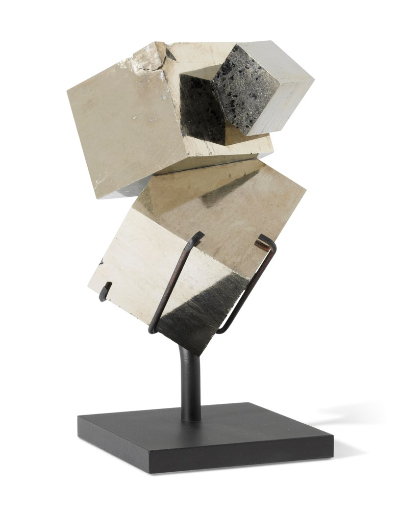 A cluster of pyrite cubes, Spain. 5½ x 2¾ x 2¾ in (14 x 7 x 7 cm). Estimate                    £1,500-2,500. This lot is offered in Sculpted by Nature Fossils, Minerals and Meteorites, 10-17 April 2018, Online