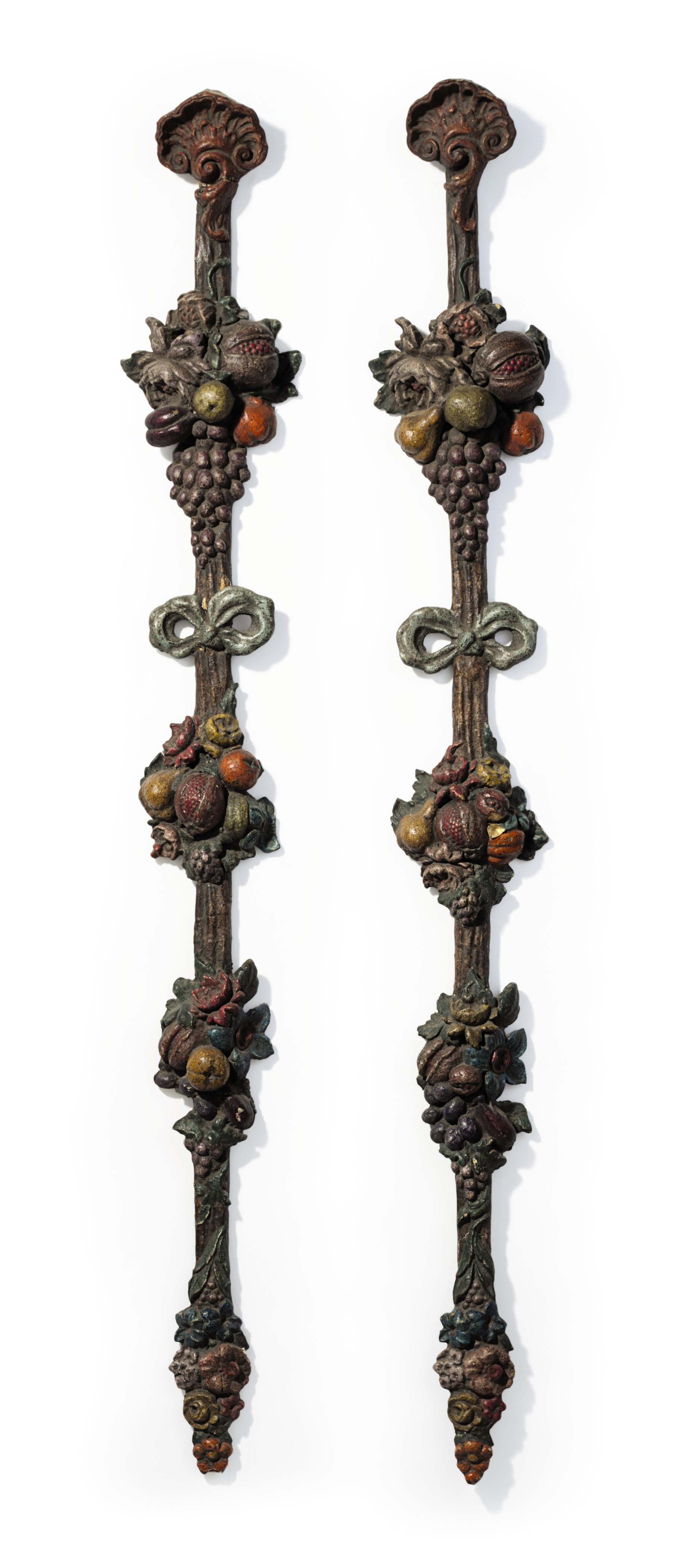 A PAIR OF VICTORIAN POLYCHROME-PAINTED COMPOSITION WALL HANGINGS