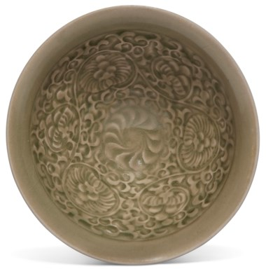 A yaozhou celadon molded bowl, Song-jin dynasty (960-1234). 5⅛ in (13.1 cm) diam, cloth box. Estimate $2,000-4,000 (£1,585.20 - GBP 3,170.40). Offered in The Art of China New York, Winter Edition, 5-12 December 2018, Online