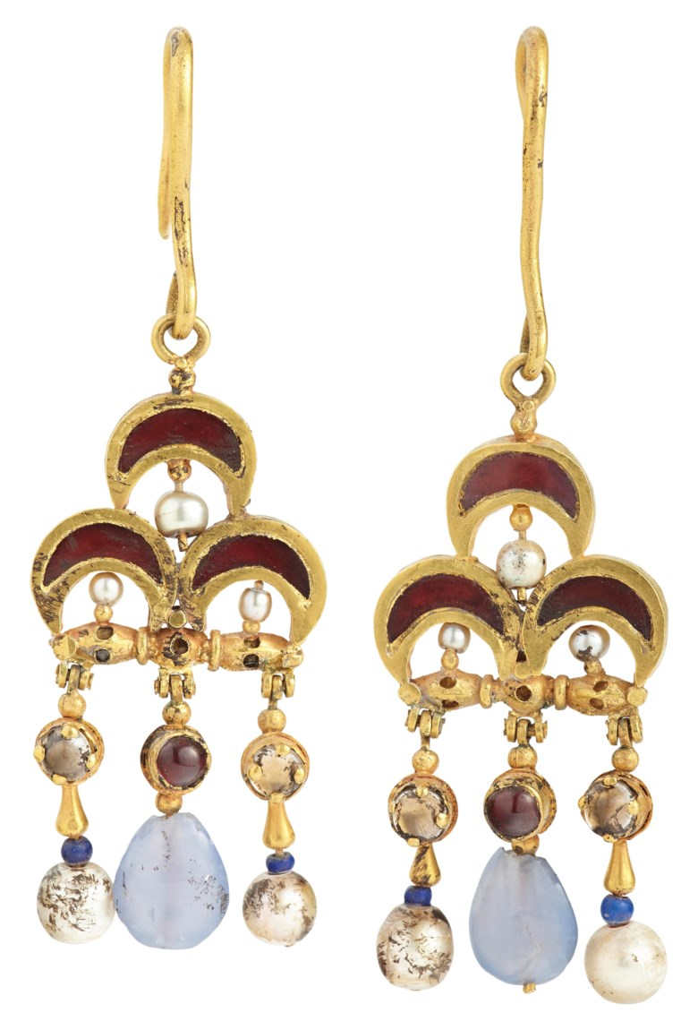 A pair of Byzantine gold, garnet, pearl and sapphire earrings, circa 6th-7th century AD. Each 3½ in (8.8 cm) long.