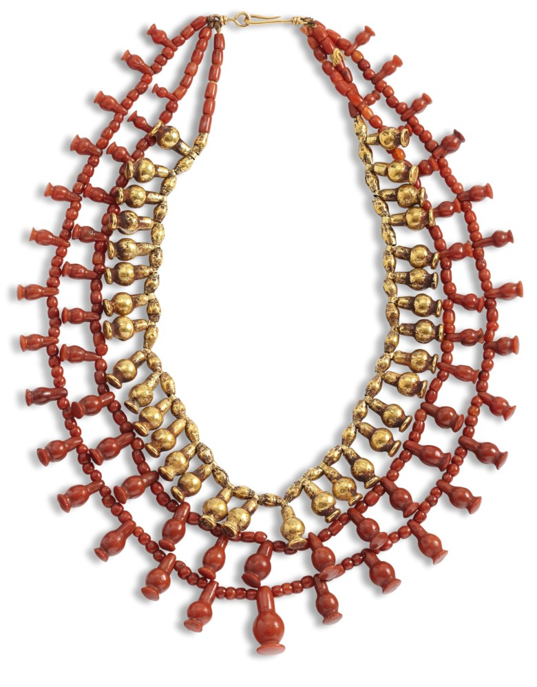 An Egyptian gold and carnelian multi-strand bead necklace, New Kingdom, 18th-20th dynasty, 1550-1070 BC. 14 in (35.5 cm) long as strung.