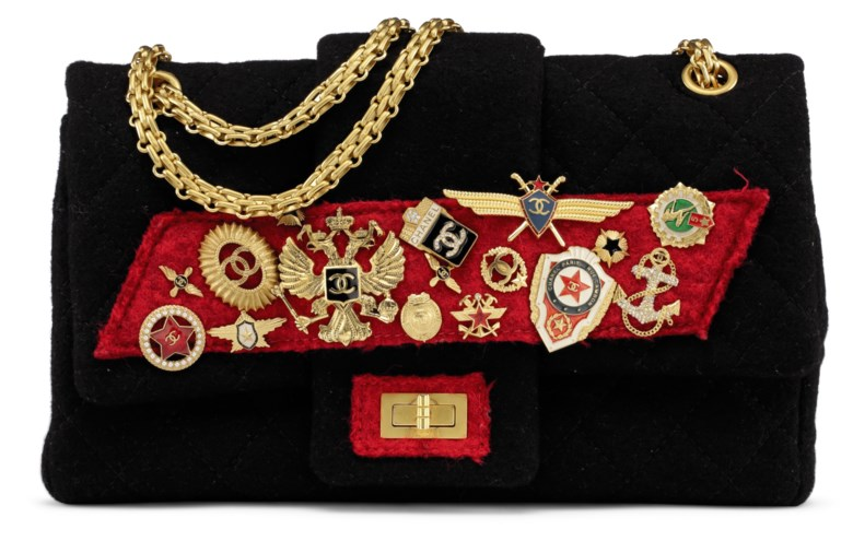 A métiers dart paris-moscou red & black embellished felt double flap with gold hardware, Chanel,2009. 28 w x 17 h x 10 d cm. Estimate                    $2,000-4,000. Offered in Handbags & Accessories, 29 May to 19 June 2018, Online
